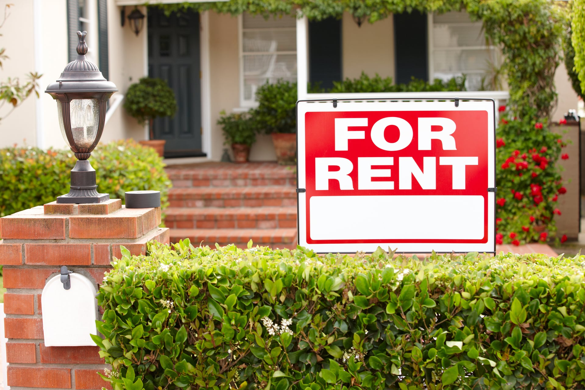 for rent sign outside of a house