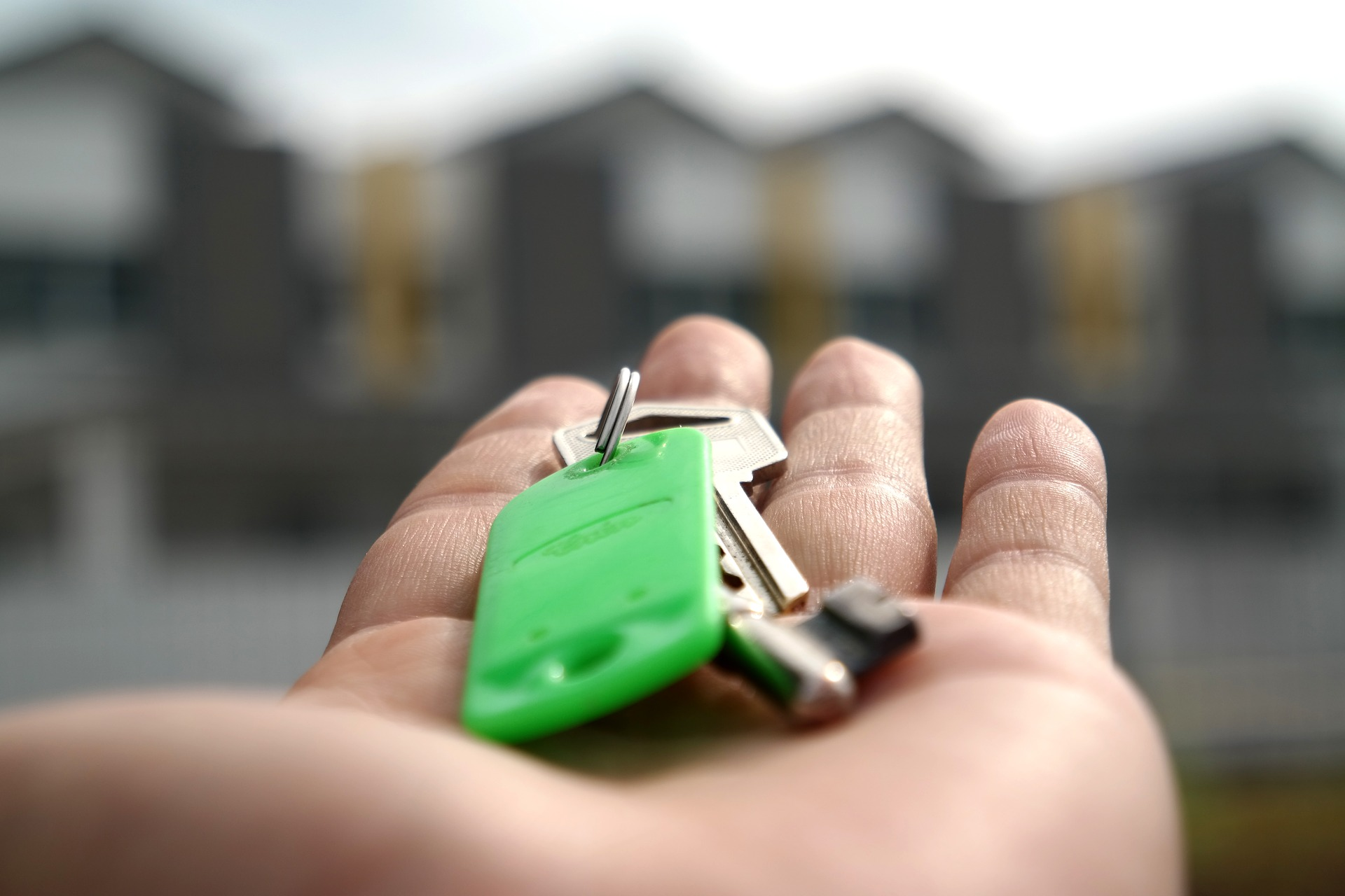 house keys in palm of hand